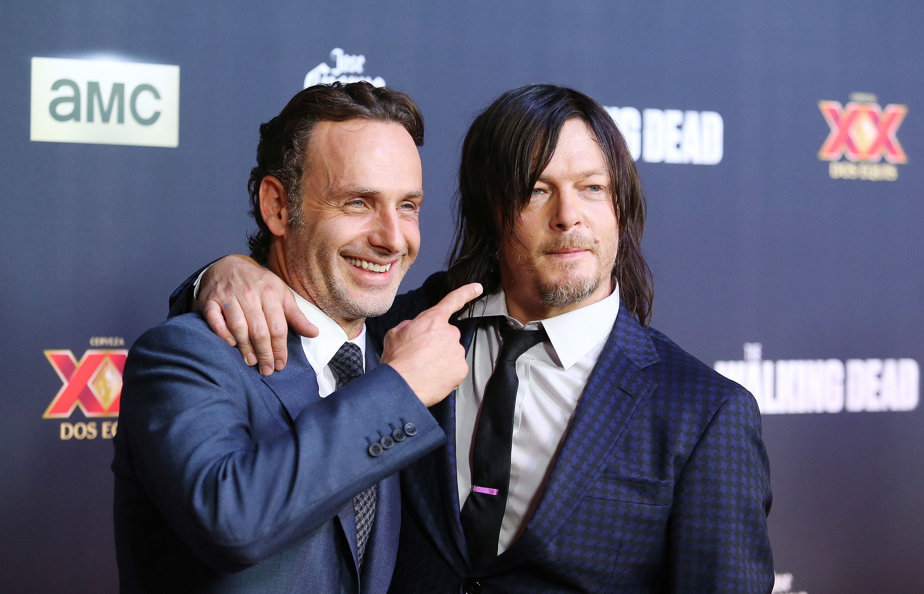 UNIVERSAL CITY, CA - OCTOBER 02:   Andrew Lincoln (L) and Norman Reedus arrive at AMC's 'The Walking Dead' Season 5 Premiere held at AMC Universal City Walk on October 2, 2014 in Universal City, California.  (Photo by Michael Tran/FilmMagic)