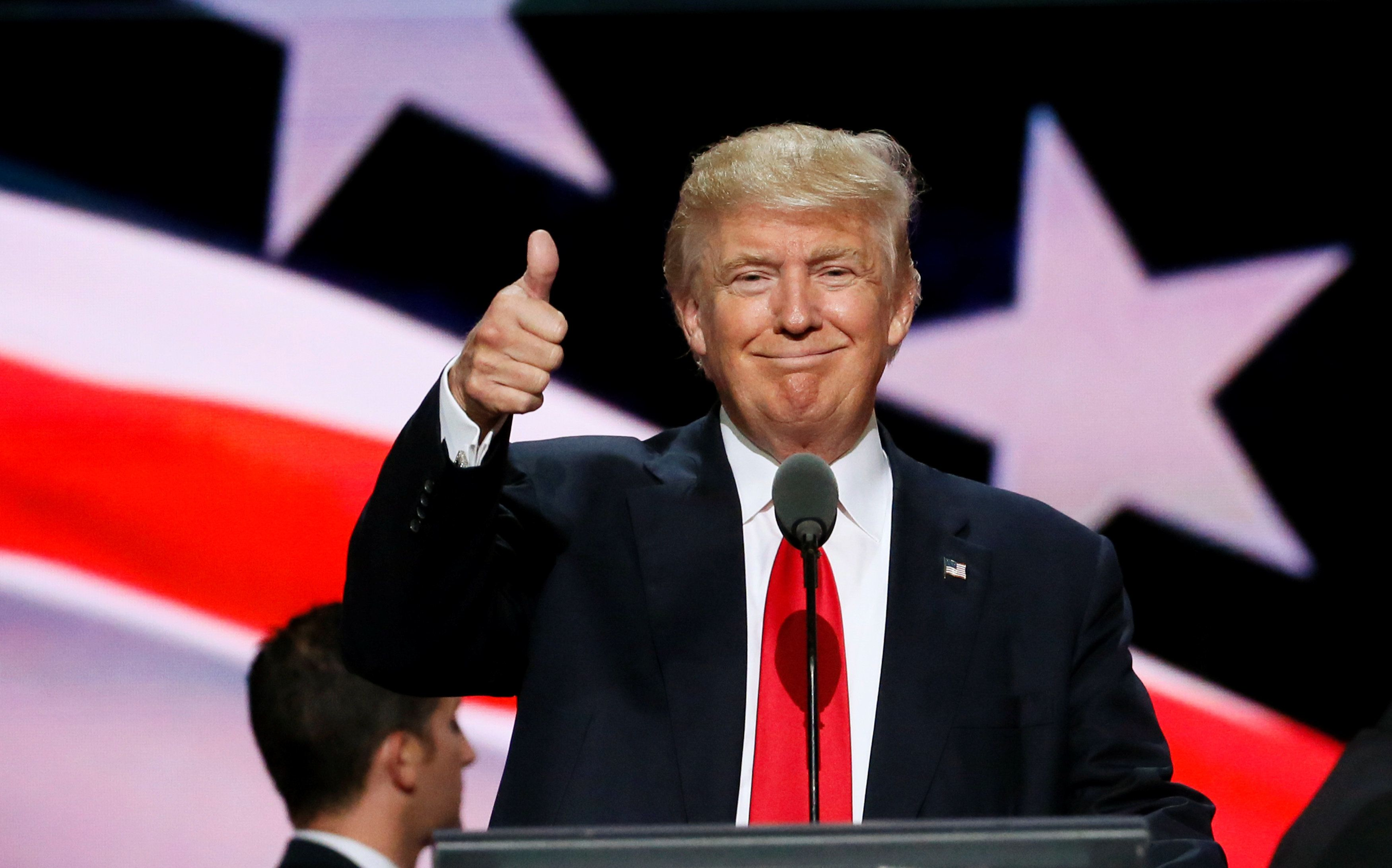 Republican presidential nominee Donald Trump gives a thumbs up during his walk through at the Republican National Convention in Cleveland, U.S., July 21, 2016.  REUTERS/Rick Wilking