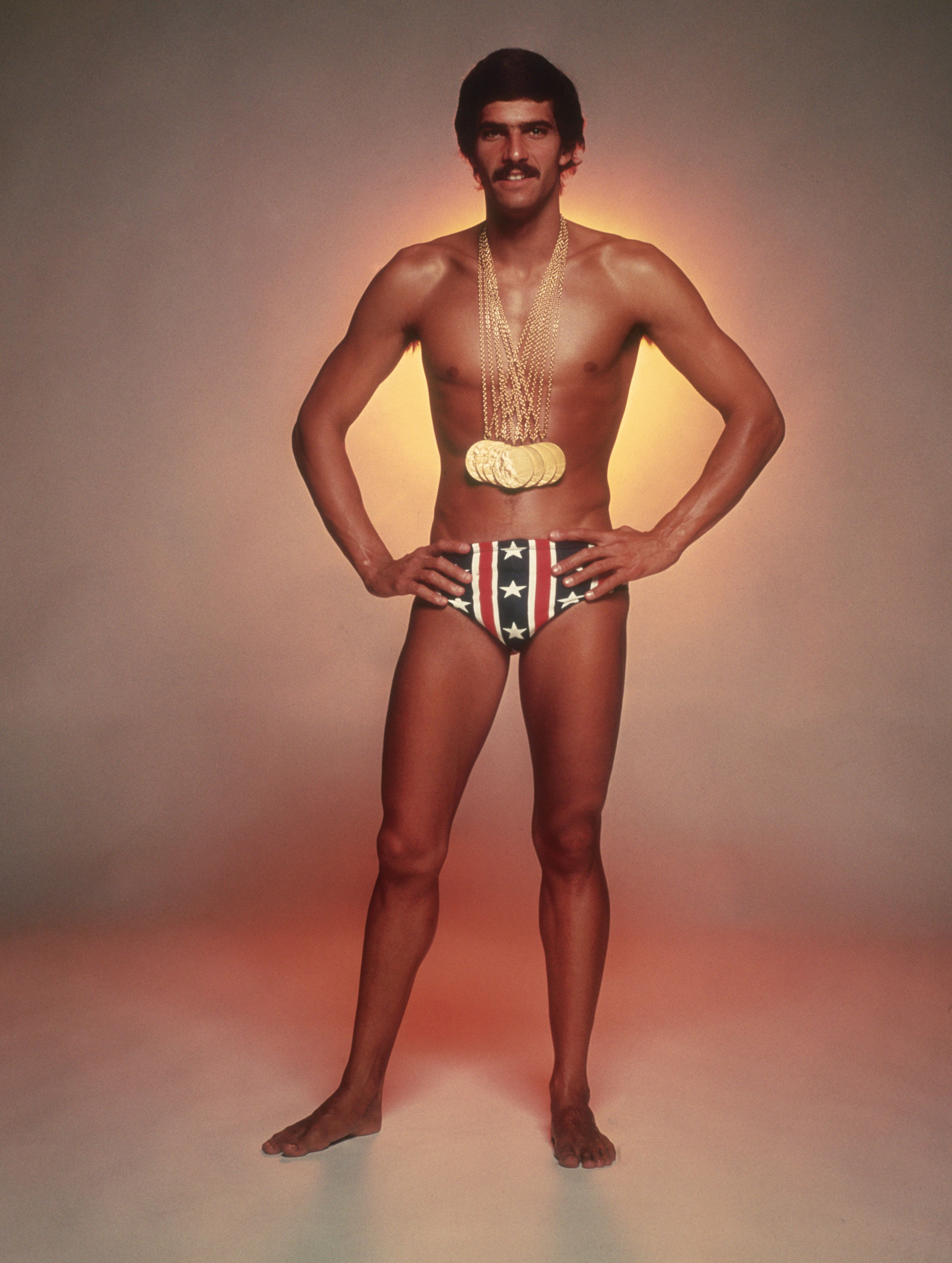 American swimmer Mark Spitz, circa 1973, with the seven gold medals, which he won at the 1972 Munich Olympic Games. (Photo by Terry O'Neill/Hulton Archive/Getty Images)