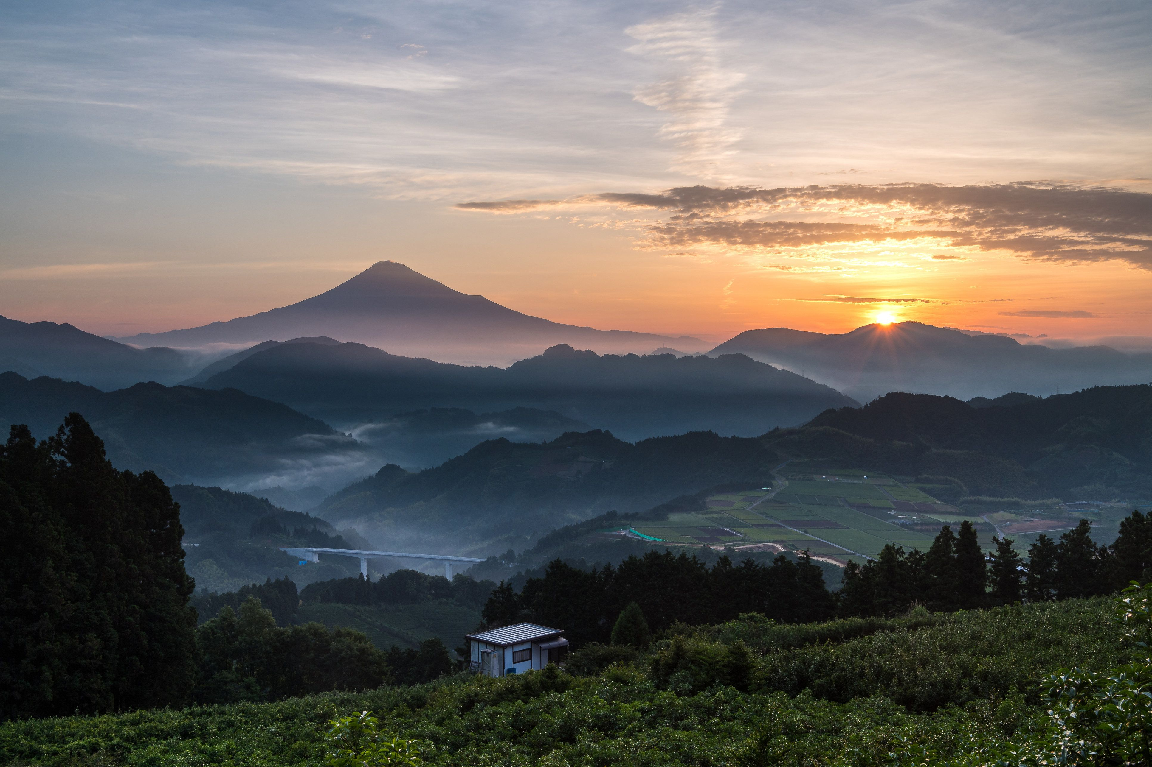 A morning moment of Mt. Fuji with sunrise in a valley in Shizuoka, Japan