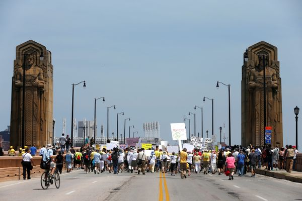 Demonstrators cross the Hope Memorial Bridge during an anti-Trump protest to coincide with the Republican National Convention