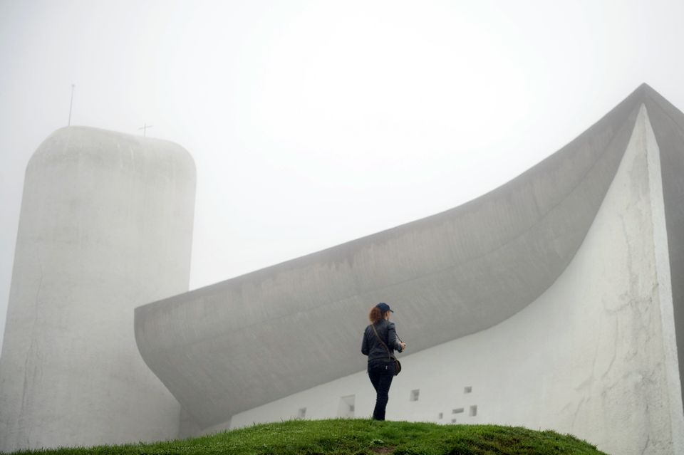 A visitor stands in front of Le Corbusier's Notre Dame du Haut chapel on Sept.9, 2011, in Ronchamp,...