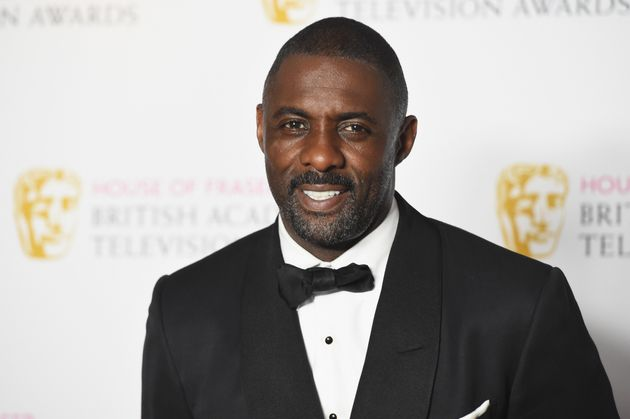 Here's a picture of Idris in a tux, just to help out the Bond