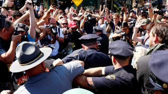 Cleveland police officers clash with a group attempting to burn a U.S. flag while protesting near the Republican National Convention in Cleveland, Ohio, U.S., July 20, 2016.  REUTERS/Lucas Jackson