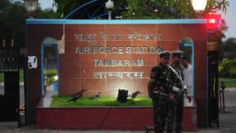 Indian Airforce personal stand guard outside Tambaram Airforce station in Chennai on July 22, 2016.    India on July 22 mounted a massive search and rescue operation for an Indian Air Force plane that went missing with 29 people on board over the Bay of Bengal. / AFP / ARUN SANKAR        (Photo credit should read ARUN SANKAR/AFP/Getty Images)