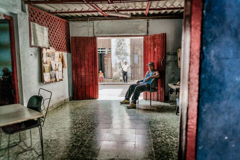 Sitting and waiting in the doorway of a boxing gym in Old Havana.