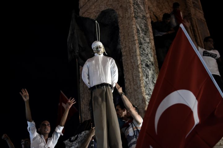 Pro-Erdogan supporters hangan effigy of U.S.-based preacher Fethullah Gulen atrally at Taksim Square in Istanbul