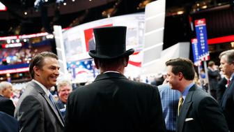 A man dressed a the late U.S. President Abraham Lincoln with Lincoln's stovepipe hat looks out at the floor of the Republican National Convention at the Republican National Convention in Cleveland, Ohio, U.S. July 18, 2016. REUTERS/Mark Kauzlarich