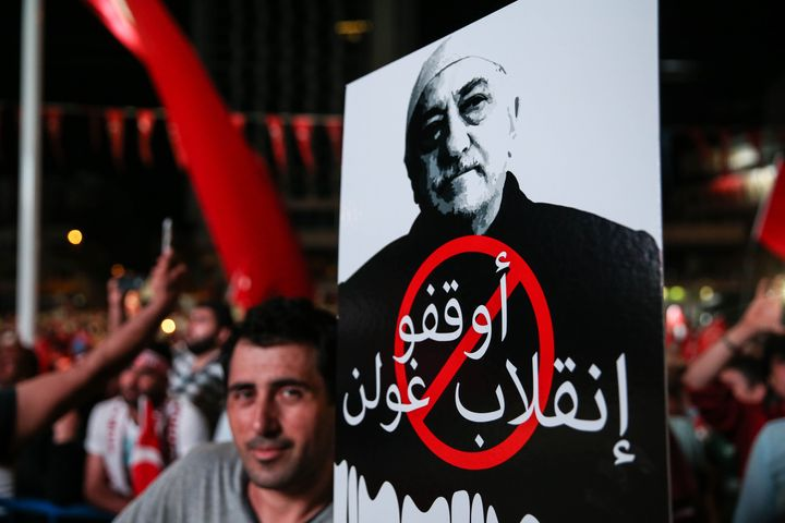 """A man holds a sign showingFethullah Gulen that reads """"Take your hands off Turkish democracy"""" in Istanbulon July 2"""