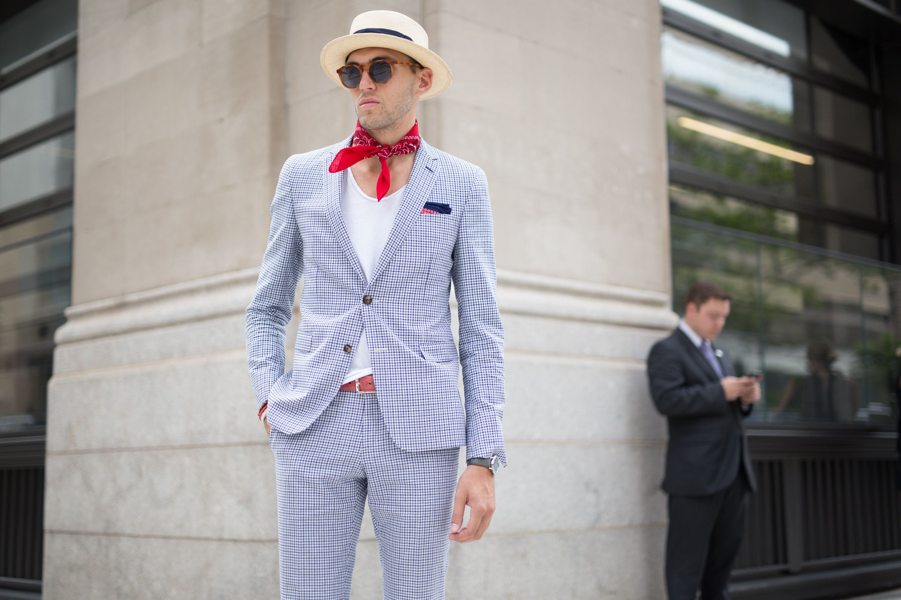A man attends a presentation during New York Fashion Week: Men'swearing -- you guessed it! -- a neck scarf.