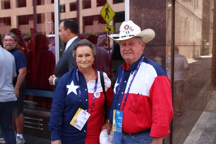 Texas alternate delegate Don Manen stands alongside his wife near the Republican National Convention in Cleveland. Like other