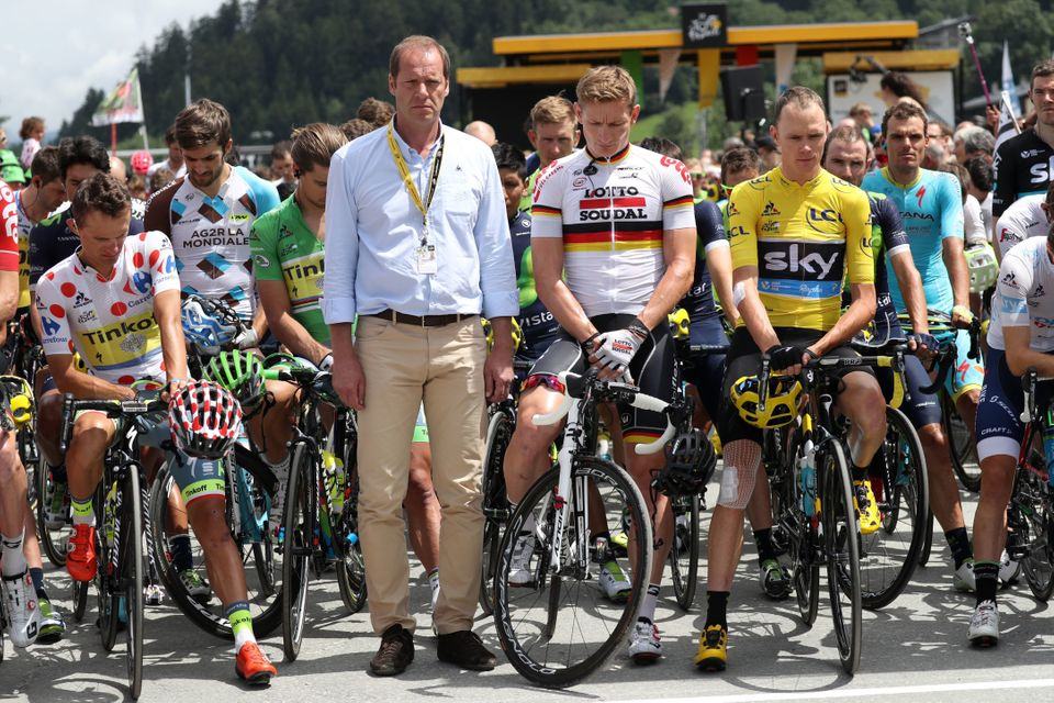 (From L) Poland's Rafal Majka, wearing the best climber's polka dot jersey, General director of the Tour de France, Christian