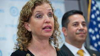 UNITED STATES - MARCH 16: DNC Chair Debbie Wasserman Schultz, D-Fla., and DCCC Chair Ben Ray Luján, D-N.M., conduct a news conference at the DNC on the latest primary election results, March 16, 2016. Former DSCC Chair Charles Schumer, D-N.Y., also attended. (Photo By Tom Williams/CQ Roll Call)