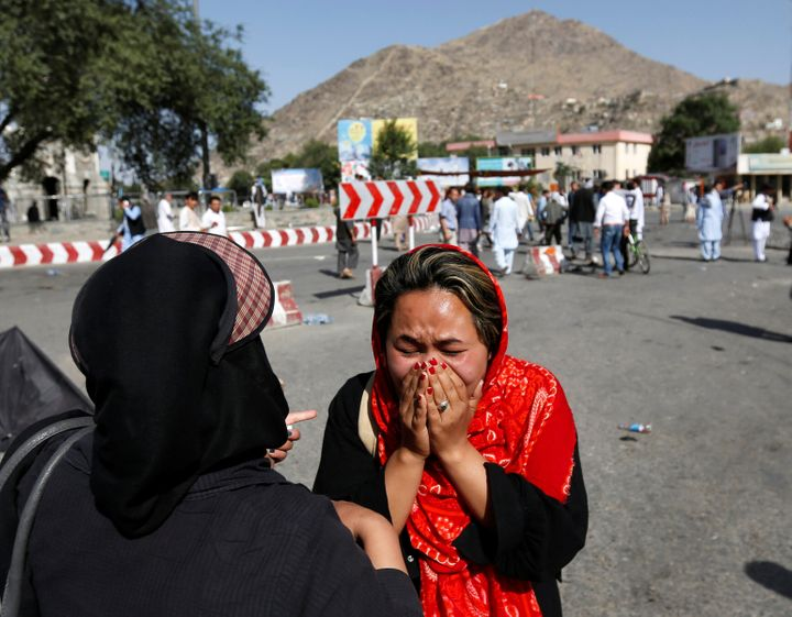 An Afghan woman weeps at the site of a suicide attack in Kabul on Saturday. The attack was claimed by the Islamic State milit