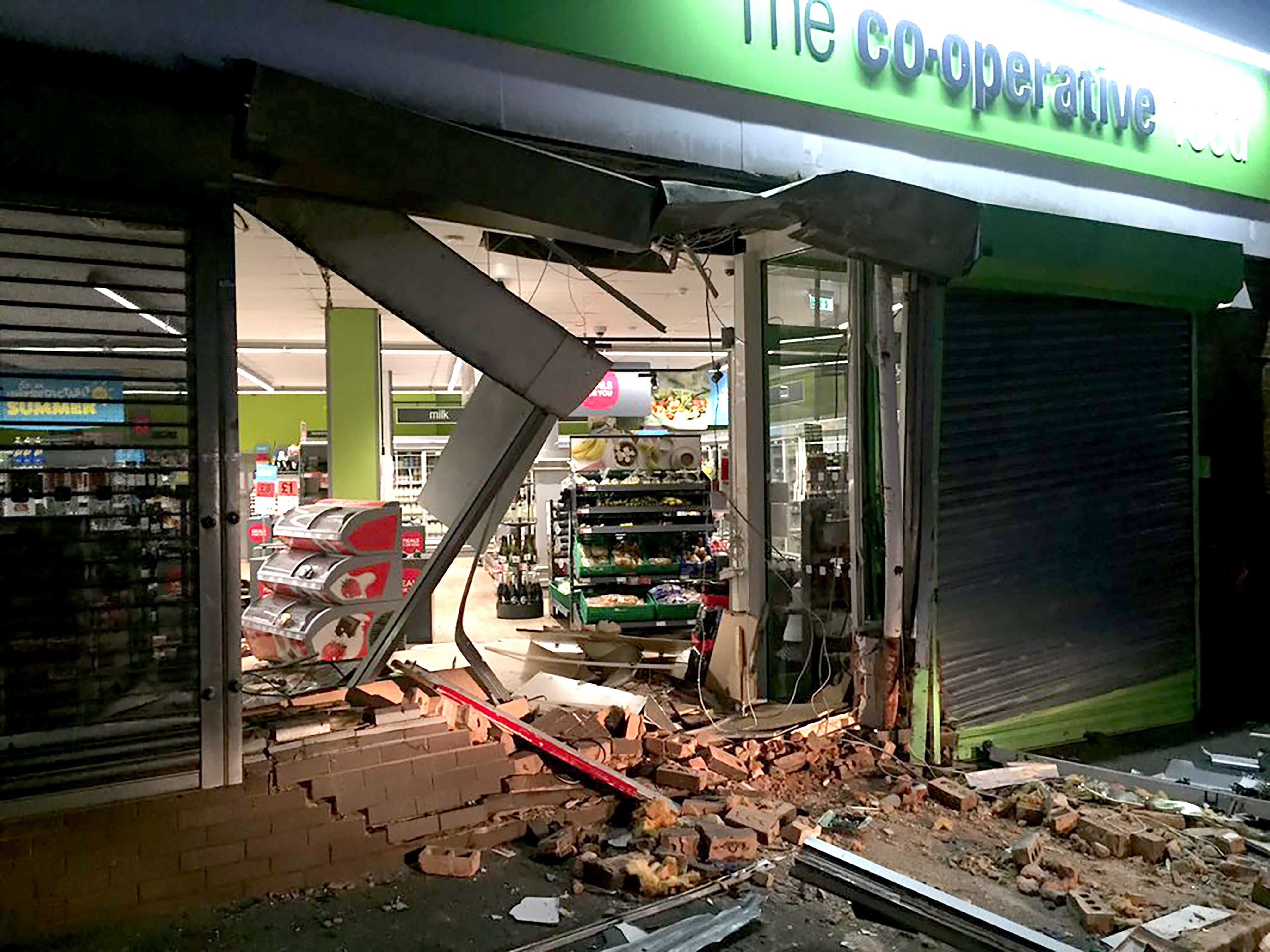 A gang of thieves used a digger to steal a cash machine in