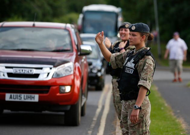 Royal Air Force police control traffic at the base on