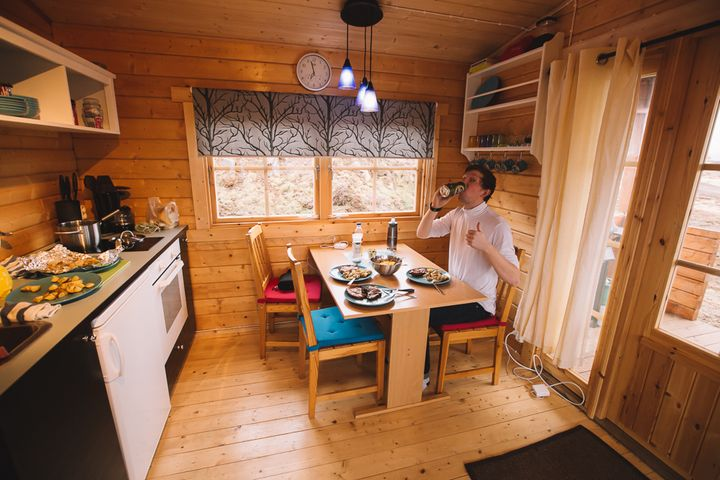 """<p><a rel=""""nofollow"""" href=""""http://www.thetravelpockets.com/new-blog/2016/4/7-day-iceland-road-trip-itinerary"""" target=""""_blank"""">ENJOYING OUR HOME COOKED MEAL IN THE CABIN</a></p>"""