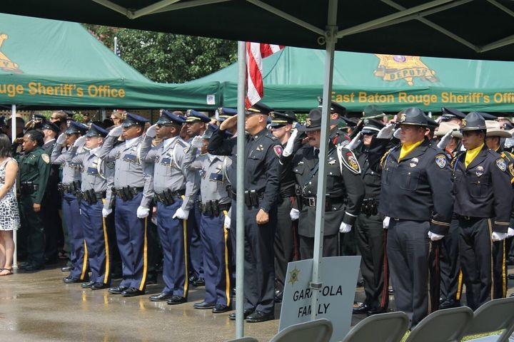 Officers pay their respects at the funeral for Deputy Brad Garafola.