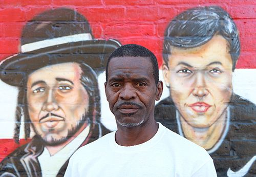 <i>Photo by Nancy A. Ruhling</i><br><strong>The mural shows the faces of the community.</strong>