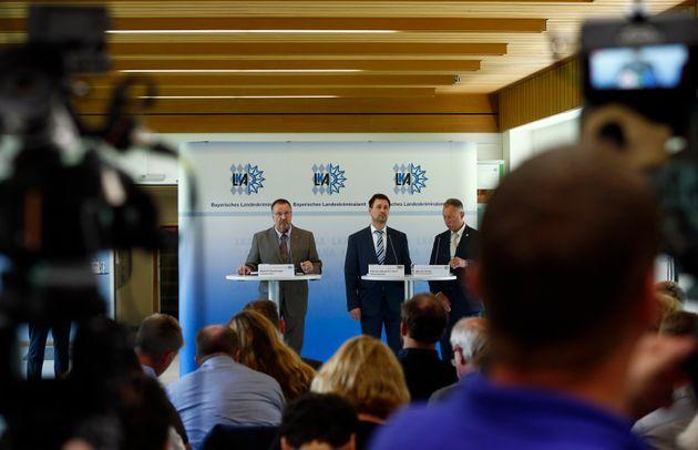 President of the Bavarian State Office of Criminal Investigation Robert Heimberger (L-R), Senior Prosecutor...