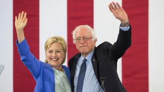 PORTSMOUTH, NH - JULY 12: U.S. Presidential candidate Hillary Clinton and U.S. Senator and former presidential candidate Bernie Sanders wave from the stage during a campaign event in Portsmouth, N.H., July 12, 2016, in which Sanders endorsed Clinton. (Photo by Keith Bedford/The Boston Globe via Getty Images)