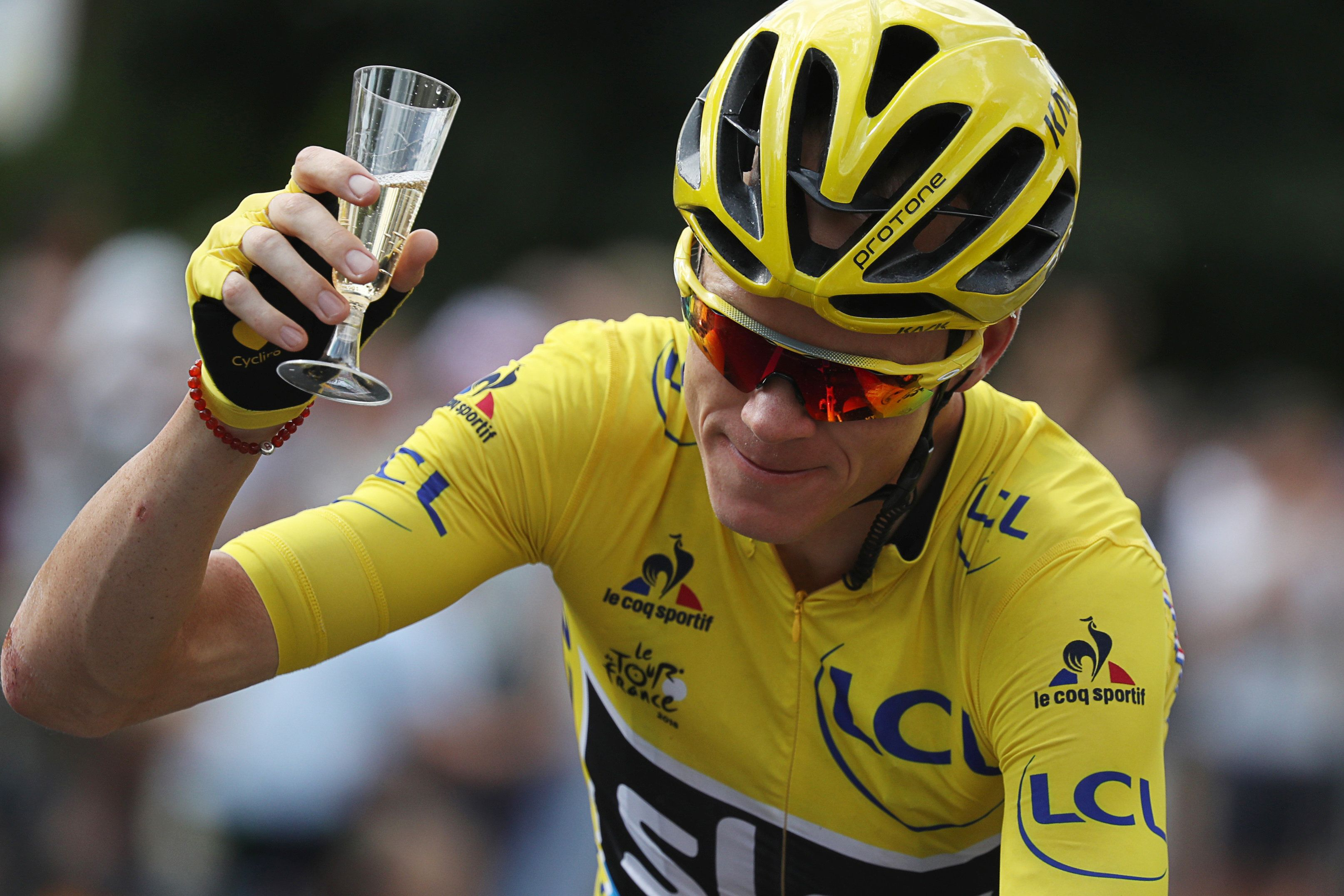 Yellow jersey leader Team Sky rider Chris Froome of Britain holds a glass of