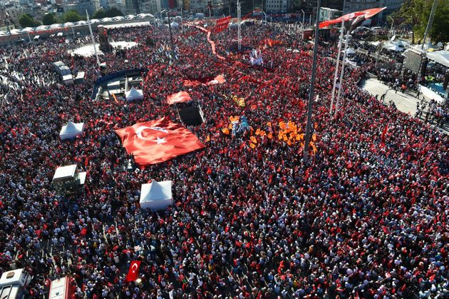 Thousands of supportersof various Turkish political parties hold Turkish flags and pictures of...