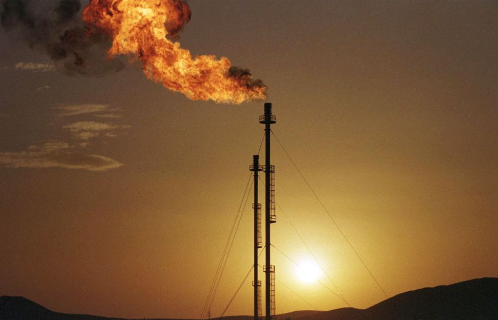 The sun sets behind the stacks at the gas plant at the state-run Sonatrach gasfileds many miles south-east of Algiers. The co