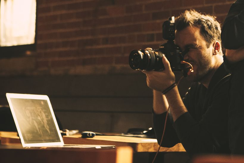 Celebrity photographer Jeremy Cowart working on a photo project