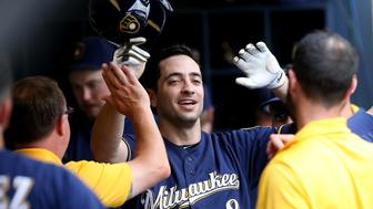 MILWAUKEE, WI - JULY 24:  Ryan Braun #8 of the Milwaukee Brewers is congratulated by teammates after scoring a run in the first inning against the Chicago Cubs at Miller Park on July 24, 2016 in Milwaukee, Wisconsin. (Photo by Dylan Buell/Getty Images)
