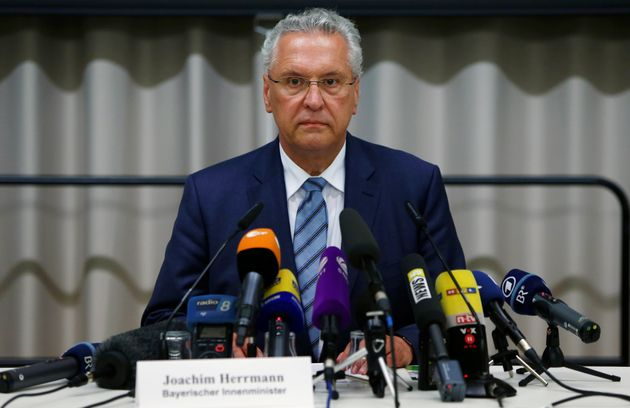 Bavarian Interior Minister Joachim Herrmann addresses a news conference after an explosion in