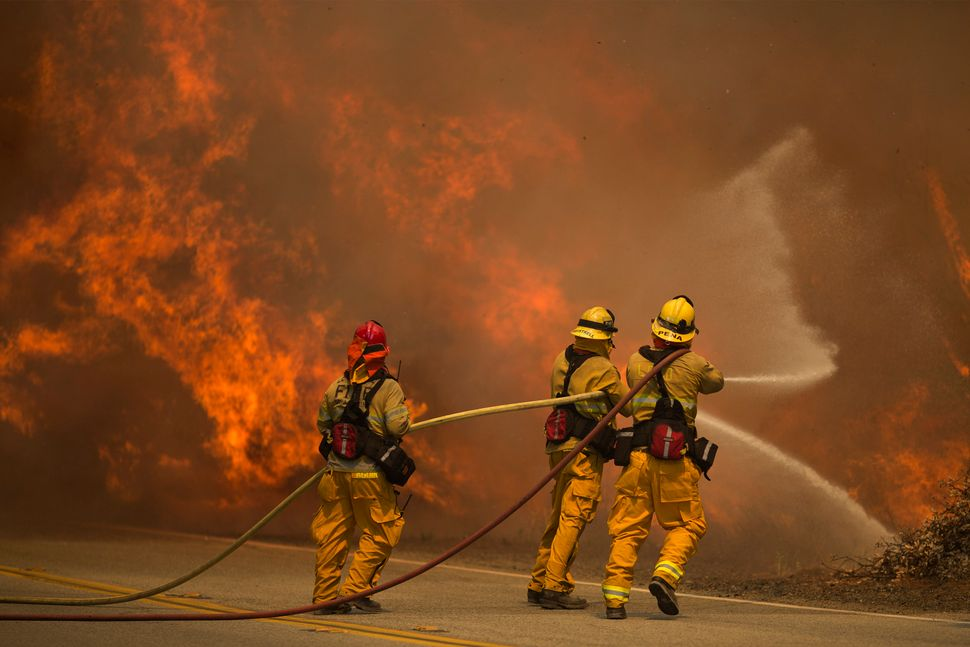 Firefighters battle flames in Placerita Canyon.