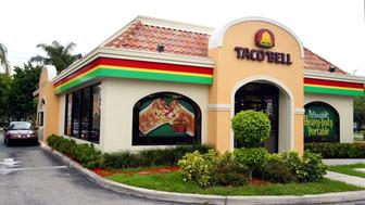 DAVIE, FL - JUNE 14:  A woman leaves a Taco Bell restaurant June 14, 2002 where 'dirty' bomb suspect Jose Padilla worked for two years in Davie, Florida. His former boss Mohammed Javed says while working as a manager of the restaurant, Jose Padilla was hired in 1992 after his release from a Broward County jail. Padilla, also known as Abdullah al Muhajir, is being held on suspicion of plotting a radioactive 'dirty' bomb attack in the U.S.  (Photo by Joe Raedle/Getty Images)