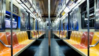 Shot of the interior of the 1 subway train at 157th and Broadway station underground.  The subway train was moving at this time and caught a cool blue flare in New York City, NY (NYC) close to mid-night.
