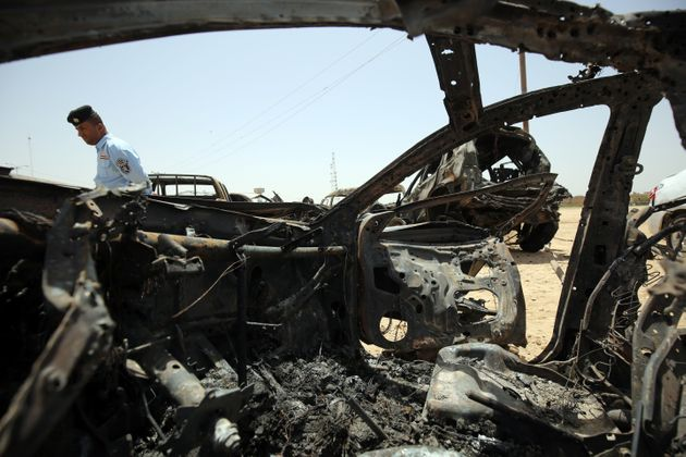 An ISIS-claimed suicide car bombing left 16 people dead outside an Iraqi town on Monday. Pictured here, an...