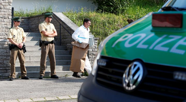 Policemen leave the flat of the 27-year-old Syrian suspect after an explosion in Ansbach near Nuremberg, Germany, July 25, 20