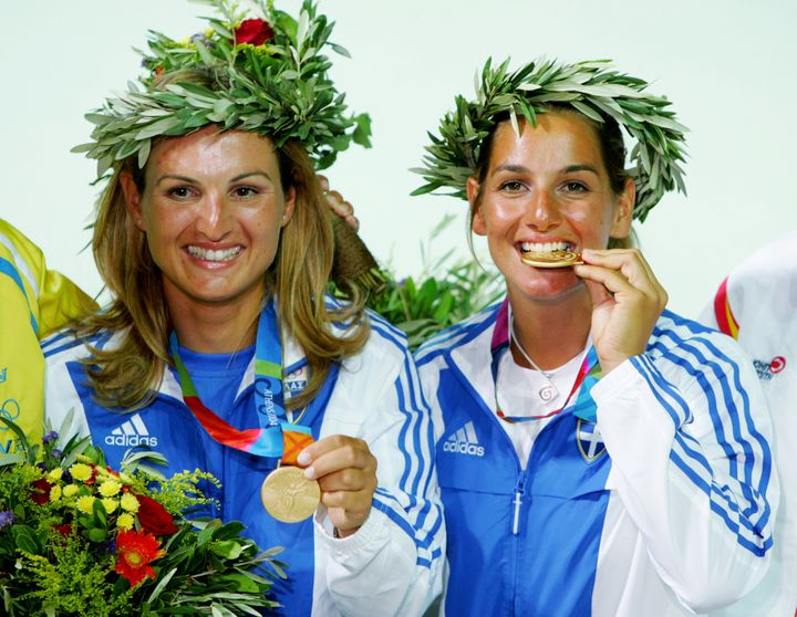 Sofia Bekatorou, right, celebrates with teammate Aimilia Tsoulfa after earning gold medals in the regatta at the 20
