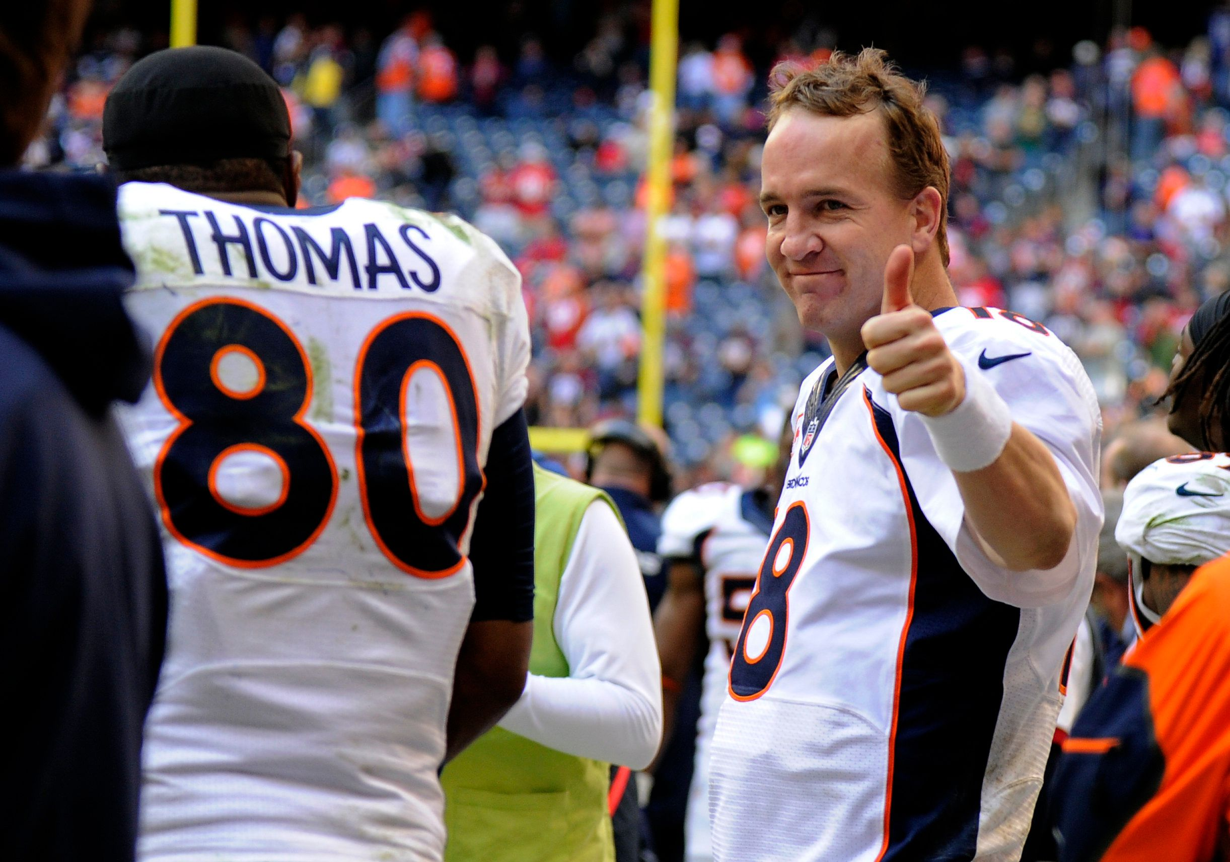 HOUSTON, TX - DECEMBER 22: Denver Broncos quarterback Peyton Manning (18) gives the thumbs up after talking to Broncos tight end Julius Thomas (80) on the bench after throwing his record breaking 51st pass to him for a touchdown in the fourth quarter against the Houston Texans December 22, 2013 at Reliant Stadium. (Photo by John Leyba/The Denver Post via Getty Images)