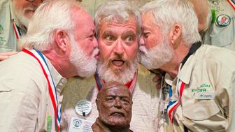 "Dave Hemingway receives smooches from Charlie Boise, (L), and Wally Collins, (R) after winning the 2016 Ernest ""Papa""  Hemingway Look-Alike Contest in Key West, Florida, U.S. in this July 23, 2016 handout photo. Success for Dave Hemingway came on the Macon, N.C., resident's seventh attempt. Dave Hemingway is not related to Ernest Hemingway who lived and wrote in Key West in the 1930s.  Rob O'Neal/Florida Keys News Bureau/Handout via REUTERS  ATTENTION EDITORS - THIS IMAGE WAS PROVIDED BY A THIRD PARTY. EDITORIAL USE ONLY"