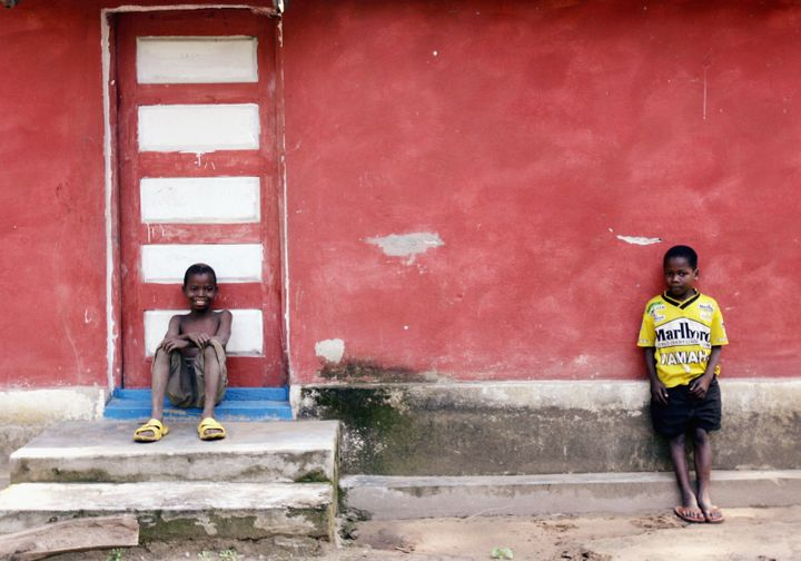 MOZAMBIQUE- JULY 2 : Two young boys stand outside their family home in a small village outside Quelimane, on July 2, 2005 in,