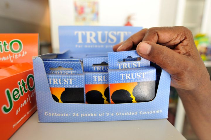 A customer picks a pack of condoms for sale at a chemist's on the outskirts of Maputo, March 19, 2009.