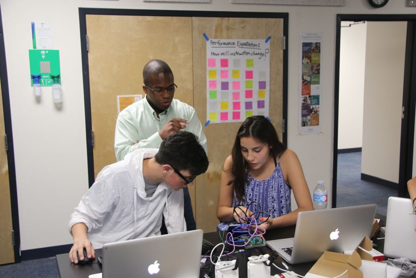 Left to right: Coding camp students Dax Compise and Andrea Ovalle; Center: Instructor Steve Callahan.