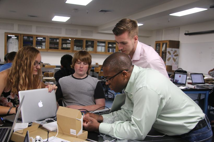 Left to right: Coding camp students Kara Kennedy and Christian McCarty; Instructors Colin Axner and Steve Callahan.