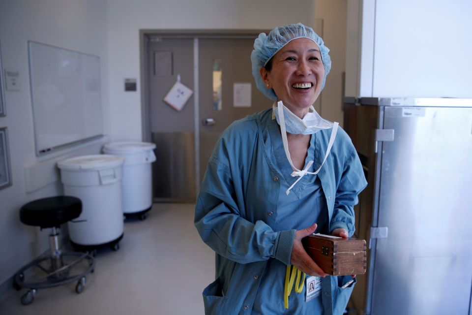 Neurosurgeon Linda Liau, MD, 49, Professor and Director of the UCLA Brain Tumor Program walks out of the operating theatre af