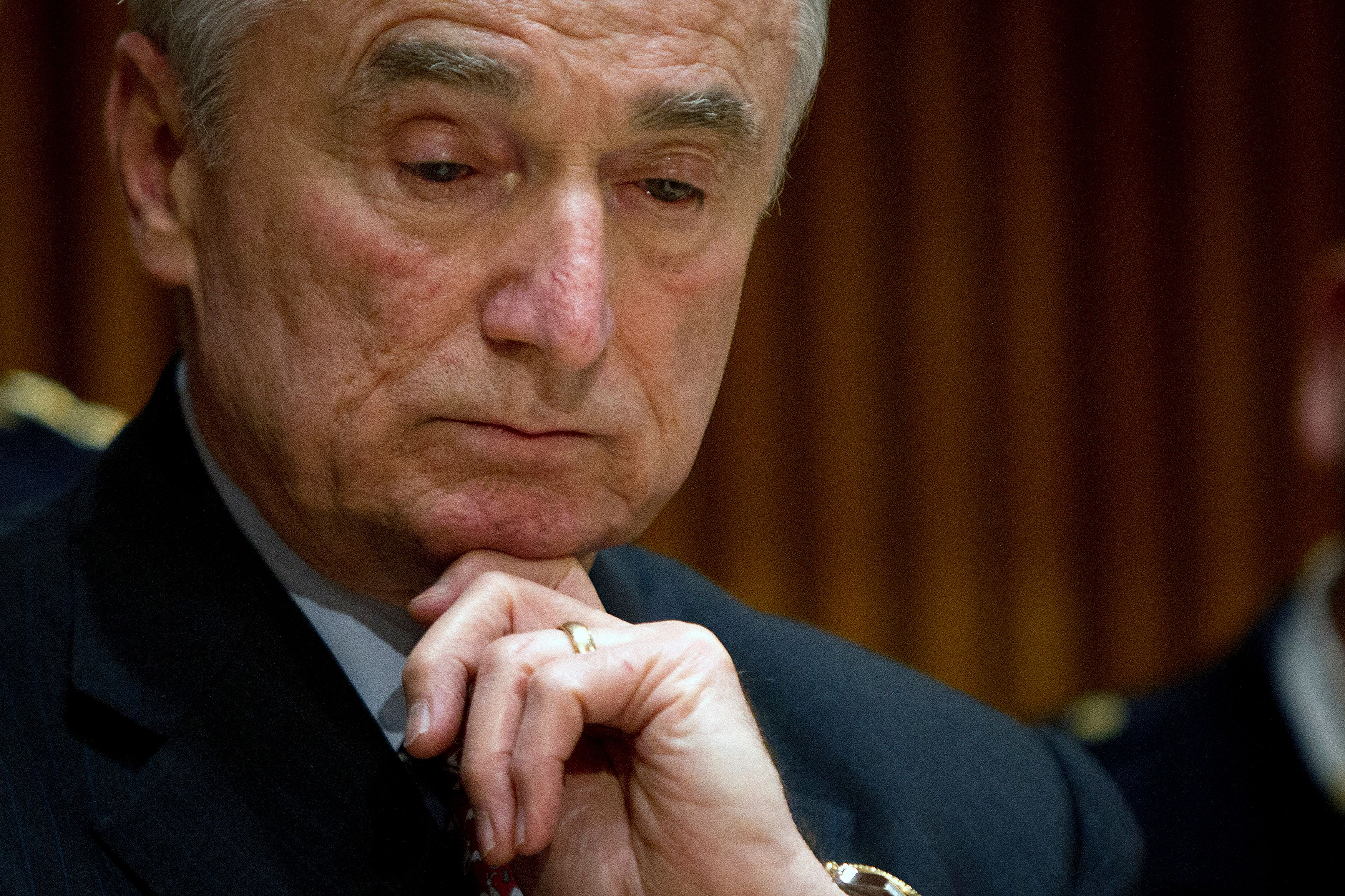 New York Police Commissioner Bill Bratton appears at a press conference about the two police officers who were shot in the head in the Brooklyn borough of New York, December 22, 2014. Bratton said the heads of the city's five police unions had agreed to suspend any lobbying efforts tied to the protests until after both NYPD officers, Rafael Ramos, 40, and his partner, Wenjian Liu, 28, are buried.    REUTERS/Carlo Allegri   (UNITED STATES - Tags: SOCIETY CIVIL UNREST)