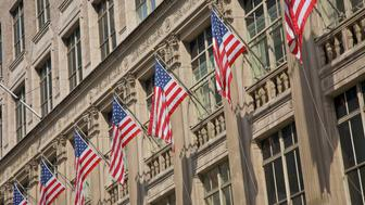 American flags hanging outside Saks Fifth Avenue, New York