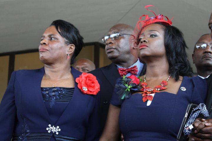 Trenisha Jackson, right, wife of slain Baton Rouge police officer Montrell Jackson, attends the funeral for her husband on Mo