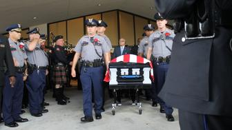 The casket for slain Baton Rouge police officer Montrell Jackson departs his funeral on Monday, July 25, 2016.