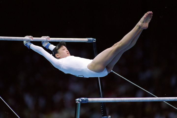 Amy Chow on the uneven bars during her routine at the Georgia Dome in the 1996 Olympic Games.