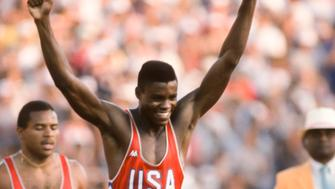 LOS ANGELES -  AUGUST 4:  Carl Lewis #915 of the USA celebrates his victory in the Men's 100m race of the Track and Field competition of the 1984 Olympic Games held on August 4, 1984 in the Los Angeles Coliseum in Los Angeles, California.  Ron Brown #887 (USA) is visible in background. (Photo by David Madison/Getty Images)